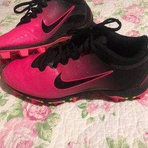 Pink and black cleats